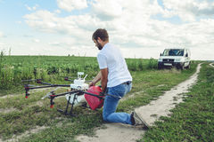View from the back process of preparing agro drones for irrigation. royalty free stock photos
