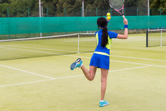 View from the back on tennis player serving outdoor Royalty Free Stock Photos