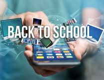 Back to school title surounded by device like smartphone, tablet. View of a Back to school title surounded by device like smartphone, tablet or laptop - Internet Royalty Free Stock Images