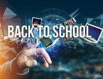 Back to school title surounded by device like smartphone, tablet Royalty Free Stock Images