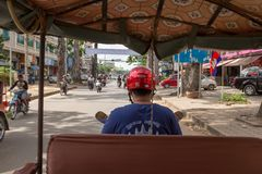 The view from the back of tuk tuk as it weaves through the busy streets of Siem Reap, Cambodia stock image