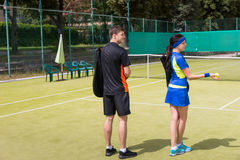 View from the back on two young tennis players on a court outdoo Royalty Free Stock Photos