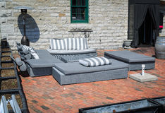 View of back yard with stylish modern patio furniture Stock Photography