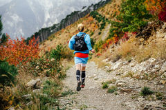 View back young female runner runs mountain trail royalty free stock image