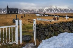 Black church, Budir, West Iceland - February 23, 2019 : View from the backside on the graveyard and the famous black church of Bud stock photo