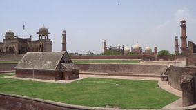 Lahore fort view. View of Badshahi Mosque and Alamgiri Gate from the Lahore Fort on a Sunny Blue Sky Day stock footage