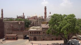 Lahore fort view. View of Badshahi Mosque and Gurdwara Dera Sahib Sikh Temple from the Lahore Fort on a Sunny Blue Sky Day stock video footage