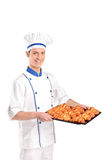 View of a baker holding croissants Royalty Free Stock Photos