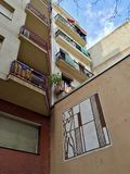 View of Balconies Displaying Spain`s Flag and Public Art royalty free stock image