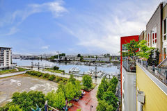 View from the balcony of modern building with marina. Tacoma. Royalty Free Stock Photography