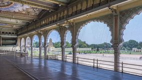 Balcony of the Mysore Palace amid Artistic Arches. View of the balcony of the mysore place from where the entire foreground or the entrance is visible. nnThis royalty free stock photo