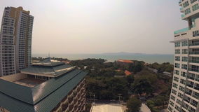 View from balcony of tropical resort. Hotels trees blue turquoise sea. Action camera stock video