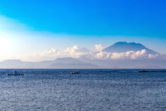 View on Bali from ocean, vulcano in clouds Stock Image