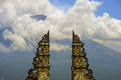 View of Bali volcano Mount Agung through the beautiful and majestic gate of the hindu Pura Lempuyan temple of Indonesia in Asia ho. Amazing view of Bali volcano stock photography