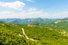View the Balkan Mountains in the summer in Montenegro former Yugoslavia covered  green trees Stock Photo