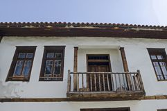 View of balkony, door and windows at the authentic ancient house from hoary antiquity Varosha