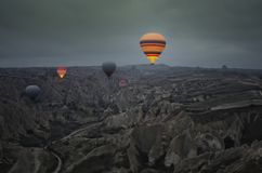 Balloon tour over the fairy chimneys at early morning at Cappadocia royalty free stock photography