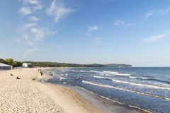 Few people at a beach in Sopot. View of the Baltic Sea and few people at a beach in Sopot, Poland, on a sunny day in the autumn. Copy space Royalty Free Stock Photography