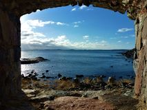 View on the baltic sea from loophole on the island of Suomenlinna. Finland royalty free stock images