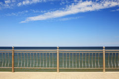 View on Baltic Sea. Through metal handrails. The sky is almost clear royalty free stock images