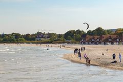 People at a beach in Sopot. View of the Baltic Sea and people at a beach in Sopot, Poland, on a sunny day in the autumn Royalty Free Stock Photos