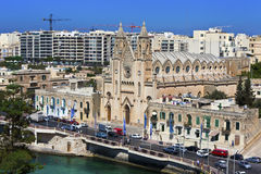View of Baluta Church at St. Julian's, Malta. Cityscape with Neo-gothic Carmelite Parish Church in Balluta Bay, St Julian's, Island of Malta, July 11, 2013 Royalty Free Stock Images