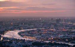 View of Bangkok city at sunset. Grand palace and Wat Phra Kaeo Stock Image