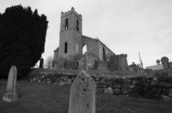 View of Bankfoot Church Ruins and Graveyard, Perthshire. A view across an old graveyard toward a ruined church building in the village of Bankfoot in Perthshire Stock Image