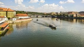 View banks of the Vltava River , tourist boats and the Manesuv Bridge in the historical center of Prague, Czech Republic. royalty free stock photos