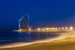 View of Barcelona Beach in summer night along seaside in Barcelo. Na, Spain. Mediterranean Sea in Spain Royalty Free Stock Photo