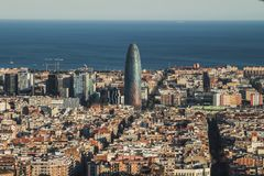 A view of Barcelona city, with the mediterranean sea at the bottom. A view of Barcelona city, Spain, with the mediterranean sea at the bottom and some emblematic royalty free stock photo