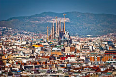 View of Barcelona showing the Sagrada Familia. View over the rooftops of Barcelona in Spain showing the Roman Catholic church of Sagrada Familia Stock Photos