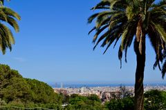 Barcelona skyline toward ocean. View of the Barcelona skyline looking toward the ocean from Park Guell, located in Catalonia, Barcelona, Spain stock image
