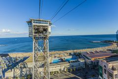 View of Barceloneta beach with the tower of its Harbor cable car royalty free stock images