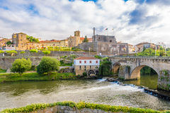 View at the Barcelos city with Cavado river in Portugal. BARCELOS,PORTUGAL - MAY 14,2017 - View at the Barcelos city with Cavado river in Portugal.The town stock photos