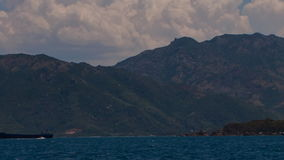 View of barge against mountain coastline clouds and sea stock video