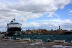 View on Bari and a ship in the port of Bari. View on the ship in the port of Bari with the panorama of the city on the background Stock Photography