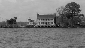 View of the Barker House Across the Bay. The Barker House, historic site in Edenton, North Carolina. Roanoke River Lighthouse in the background stock photography