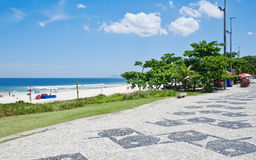 View of Barra da Tijuca beach with palms and mosaic of sidewalk Royalty Free Stock Photography