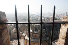 View through the bars of Tortosa with Cathedral from Suda castle Stock Photos
