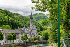 View of the basilica of Lourdes in France. View of the basilica of Lourdes city in France royalty free stock photos