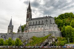 View of the basilica of Lourdes in France. View of the basilica of Lourdes city in France stock images