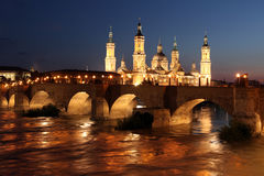 View of the basilica of the Virgen del Pilar and Ebro river, on. The right is located the medieval bridge called Puente de Piedra, Zaragoza, Aragon, Spain Royalty Free Stock Photography