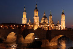 View of the basilica of the Virgen del Pilar and Ebro river, on. The right is located the medieval bridge called Puente de Piedra, Zaragoza, Aragon, Spain Stock Images