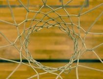 View through basketball hoop. Looking to floor through white net from up stock images