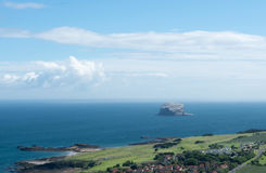 A view of the Bass Rock from the top of the North Berwick Law. On beautful sunny day with blue skies and fluffy white clouds all around Stock Images