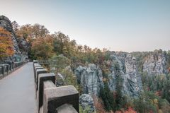 View from the Bastei bridge on the Elbsand Stein mountains in autumn mood with trees and rock formation stock photo