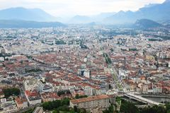 View from Bastilla upon Grenoble and french Hautes Alpes the stock image