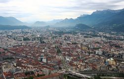 View from Bastilla mountain upon Grenoble and french Hautes Alpes stock images