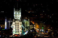 View of Bath Abbey at night with Christmas market around it Stock Images